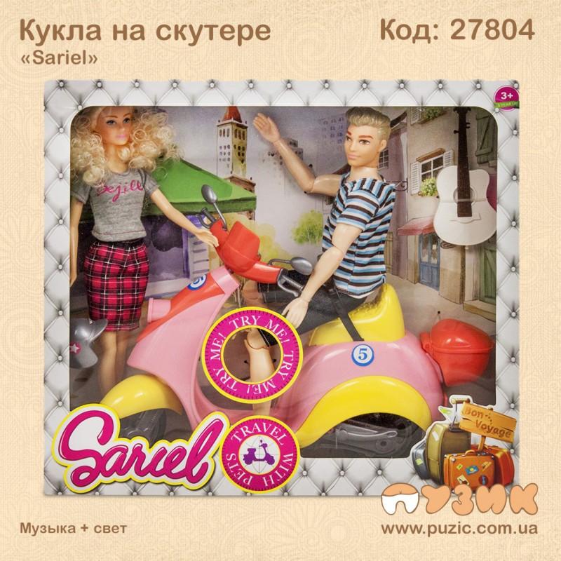 Кукла на музыкальном скутере
